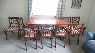 Mahogany dining table with leaf extension and 8 matching chairs