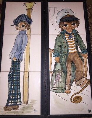 A Pair Of Jersey Pottery 3 Tile Boys Wall Plaques