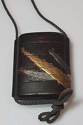 An Edo period 4 case Laquer Inro onlaid with shakudo, gold & mother of pearl.