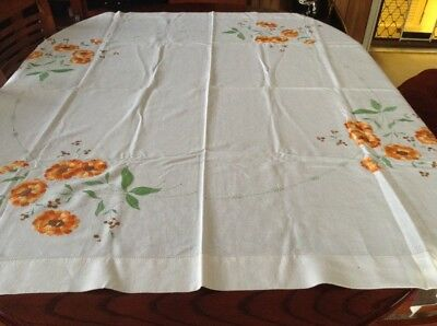 embroidered  Tablecloth With A Floral Theme In Each Corner..