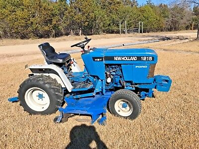 """1996 New Holland 1215 Compact Tractor w/ 60"""" Mid Mount Mower and 4' box blade"""