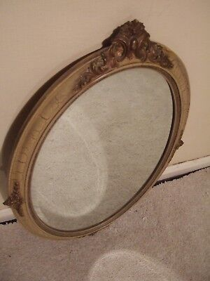 Vintage oval bevelled edge wall mirror old gold wood and stucco