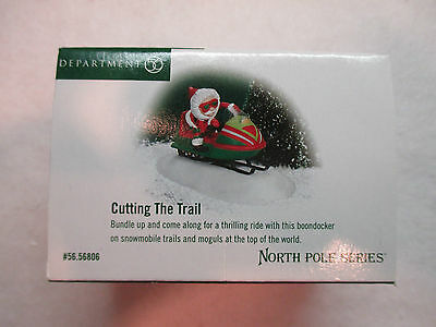 """Dept 56 North Pole Series """"Cutting The Trail""""  #56 56806"""
