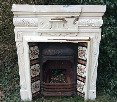 Victorian cast iron original fireplace with tile insert and grate,