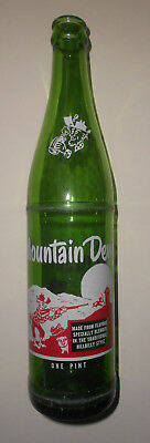 """Vintage MOUNTAIN DEW one pint pop bottle, average reused condition. 11"""" tall."""