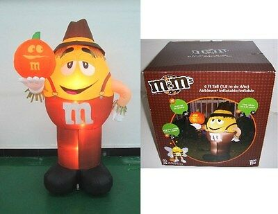 M&m's® 6' Airblown Inflatable Yellow Scarecrow W/orange Character Pumpkin