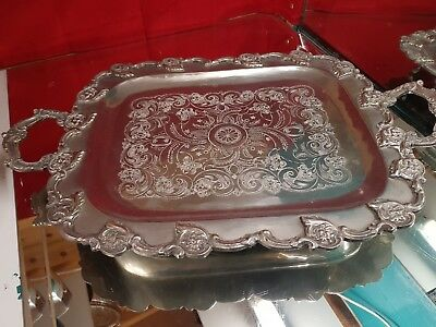 a silver plated serving tray with beautiful decorated patterns.very ornate.