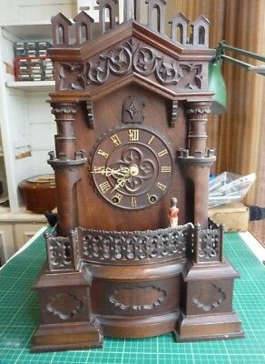An Ornate Black Forest wood framed Cuckoo clock with automated soldier.
