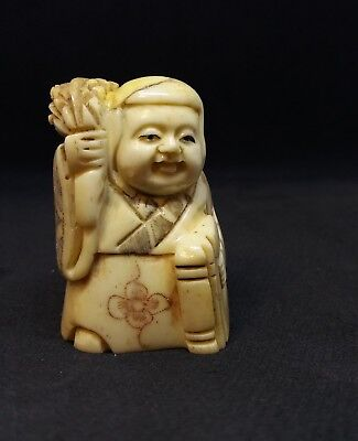 Vintage okimono hand carved cattle bone netsuke, woman with leaves