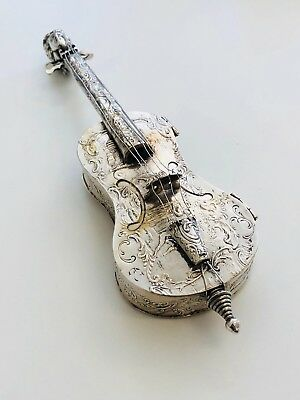 A Silver Model Of A Violin Embossed With Figures And Scrolls German