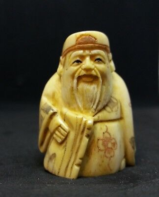 Vintage okimono hand carved cattle bone netsuke, man & hat