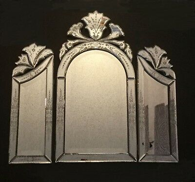 Beautiful Venetian glass tri-fold mirror.  Cut-out arched tops. Beveled glass.