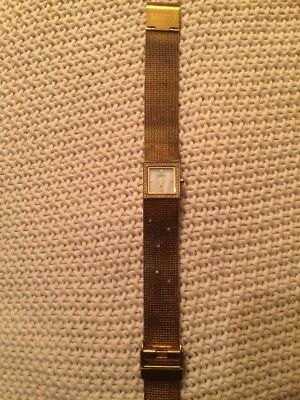 Skagen (Denmark) Gold Tone Ladies Watch with Metal Mesh Band and Mother of Pearl