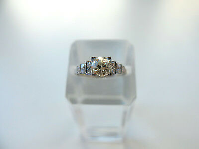 Damenring mit 1 Diamant von 0,98 ct + kl. Diamanten in Platin-Iridium