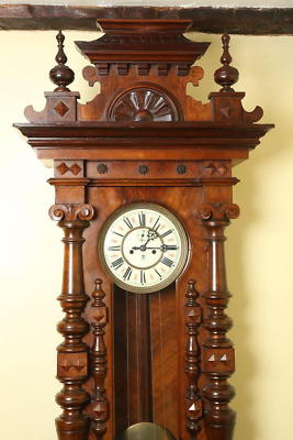 Antique-Walnut, two weight, wall clock. Made by the Gustav Becker Clock Factory
