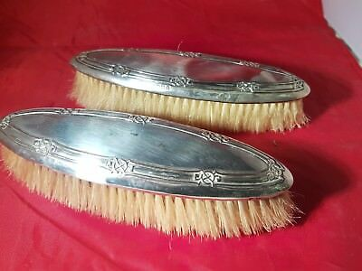 a pair of solid silver grooming brushes.birmingham.1908