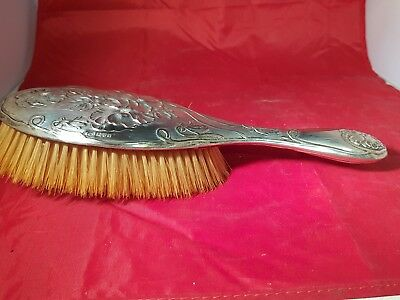 a beautifully decorated solid silver grooming brush.chester 1907