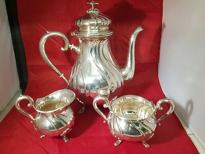 a beautiful antique silver plated tea set with elegant patterns.very ornate.