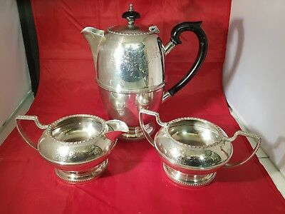 a vintage silver plated tea set with hand engraved patterns.very ornate.