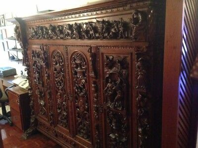 Antique European hand carved solid wood cabinet. Furniture