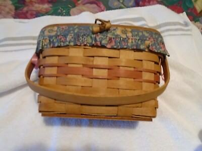 Medium Longaberger basket with attached lid leather straps and toggle closer WOW