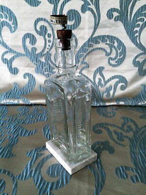 Antique Rundle's Bottle & Cork Stopper with The Rawleigh Man Cork Screw