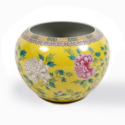 An old Chinese egg-yolk hue glazed famille rose floral fish bowl