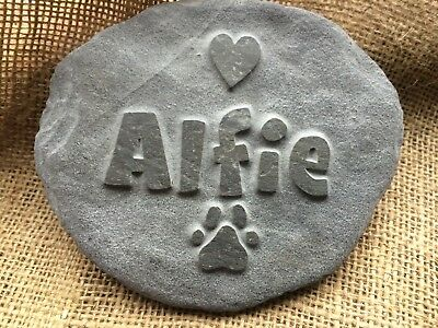 Handcarved bespoke pet memorial in natural stone, dog cat horse, hamster grave
