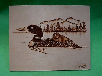 Art on board  '  Mother Loon & her baby chick  '. Wood etching & burning in fine