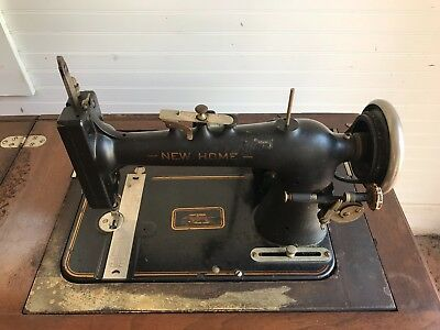 Antique New Home Sewing Machine in table (has electric cord)