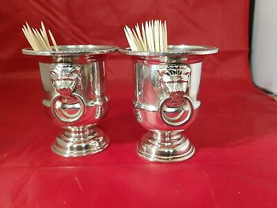 a pair of vintage silver plated cocktail stick holders by viners of sheffield.