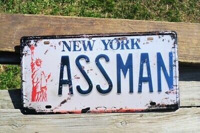 New York ASSMAN Novelty License Plate Tin Sign - Jerry Seinfeld - Cosmo Kramer