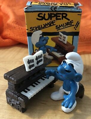 Super Smurf playing piano 1983 by Schleich German Schlumpf with box