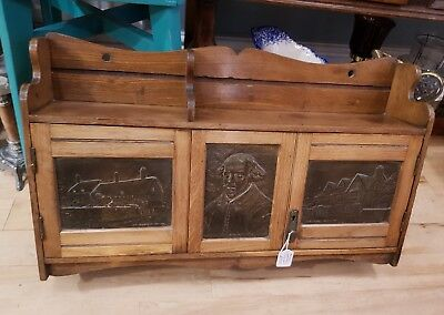 Antique writing cabinet with Shakespeare pictures