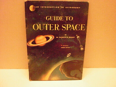 """Vintage 1960 book """"Guide To Outer Space"""" quirky and weird by today's standards."""