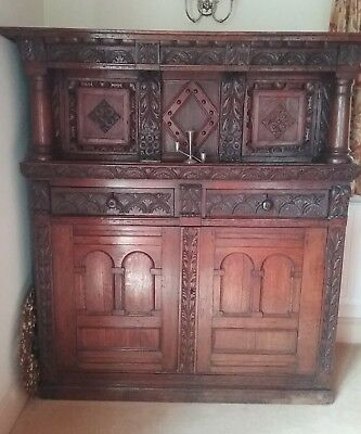 Oak court cupboard reproduction.Circa 1900. Intricate carving