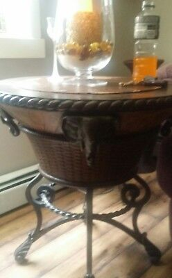 a Cherry Oak round Table steel base with a basket center around is 4 elephants