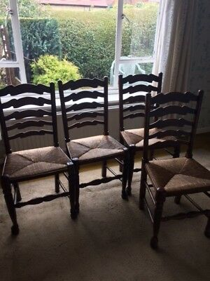 Set of four antique ladder back dining chairs