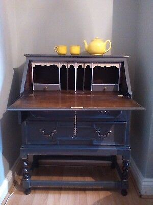 A vintage Jacobean oak wood bureau with barley twist legs