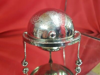 a vintage silver plated butter dish with revolving lid and elegant patterns.