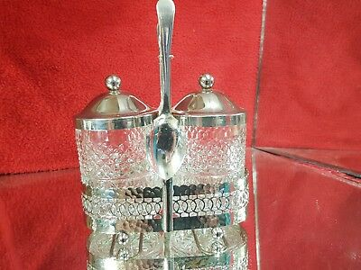 an elegant chrome plated twin preserve dish set with holder.