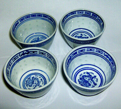 FOUR hand painted Chinese SIP CUPS (RICE PATTERN with DRAGON TO BASE OF CUPS)