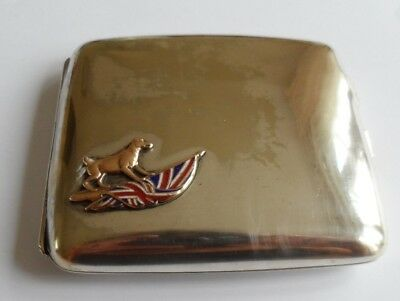 Vintage silver plated cigarette case featuring a dog poised on the Union Jack.
