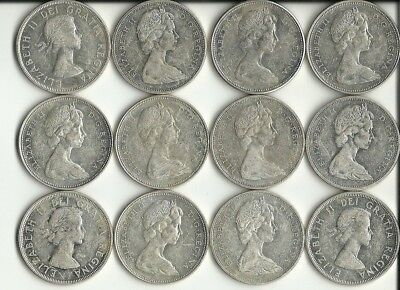 12 - Canadian Silver Dollars