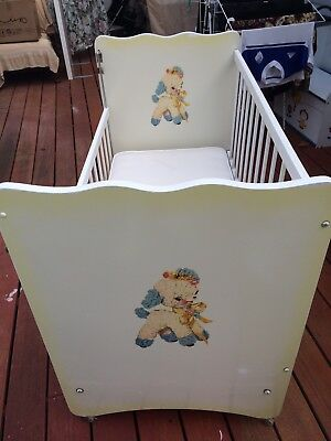 sturdy baby cot ( roller legs) with in good condition was$299