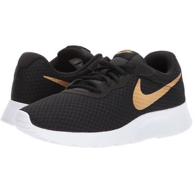 96ede1486625e ... where can i buy nike tanjun black gold running shoes boys size 4 to 7  unisex