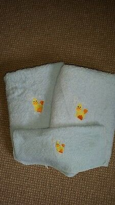 two blue baby towels with duck monogram and matching flannel