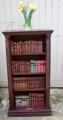 Open Bookcare In Mahogany With Fluted Columns To Either Side