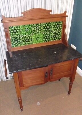 Antique tiles washstand with black marble top