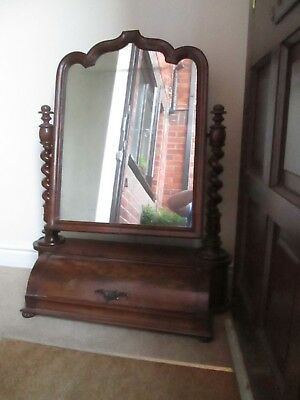 Flamed 1860's Mahogany toilet mirror with compartment.
